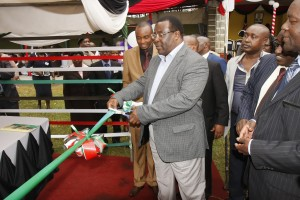 The Chief Guest Senate Speaker Hon. Ekwee Ethuro cuts the tape to launch the County Strategic Plan and new standing orders